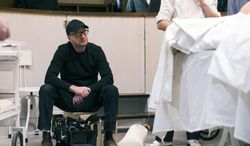 "This image released by Cinemax shows director Steven Soderbergh on the set of ""The Knick,"" a 10-episode hospital drama premiering Friday at 10 p.m. EDT on Cinemax. (AP Photo/Cinemax, Mary Cybulski)"