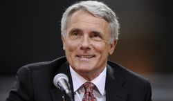 FILe - In this May 6, 2011 file photo, Maryland basketball coach Gary Williams smiles during a news conference to formally announce his retirement at the University of Maryland in College Park, Md. Williams will be inducted into the Naismith Memorial Basketball Hall of Fame on Friday, Aug. 8, 2014, in Springfield, Mass. (AP Photo/Nick Wass, File)