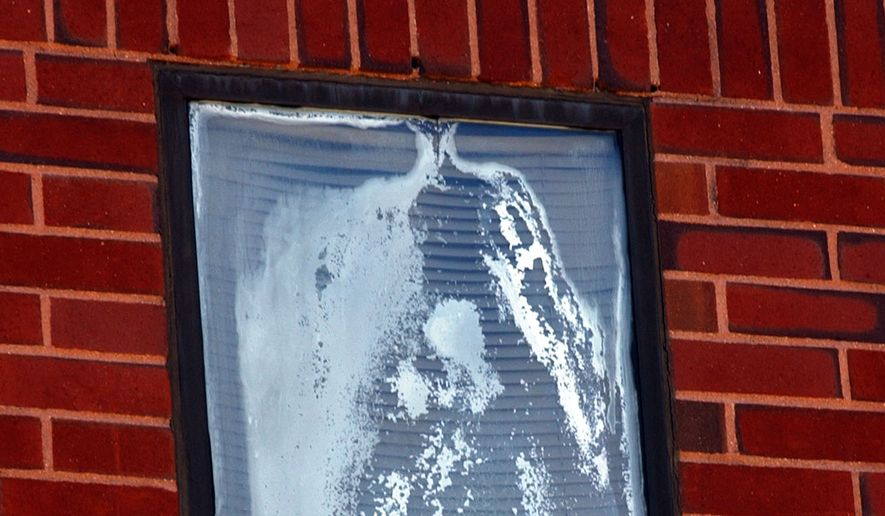 A third floor window, where visitors believe they see a white apparition of the Virgin Mary, is seen at Milton Hospital in Milton, Mass.,Tuesday, June 17, 2003. (AP Photo/Chitose Suzuki)