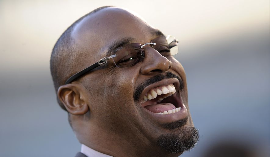 Former Philadelphia Eagles quarterback Donovan McNabb laughs during an interview before an NFL football game between the Philadelphia Eagles and the Kansas City Chiefs, Thursday, Sept. 19, 2013, in Philadelphia. (AP Photo/Michael Perez)
