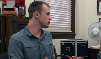 This photo provided by Eugene R. Fidell  shows Sgt. Bowe Bergdahl preparing to be interviewed by Army investigators in August, 2014.  The U.S. Army has begun questioning Bergdahl about his disappearance in Afghanistan that led to five years in captivity by the Taliban, his attorney and an Army spokeswoman said Wednesday, Aug. 6, 2014. (AP Photo/Eugene R. Fidell) MANDATORY CREDIT