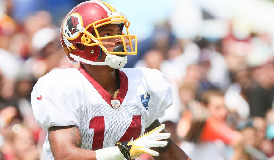 Washington Redskins WR Ryan Grant looks for a pass from Robert Griffin III before an NFL Football training camp scrimmage of New England Patriots and  Washington Redskins in Richmond, Va., Tuesday, Aug. 5, 2014. (AP Photo/Skip Rowland)
