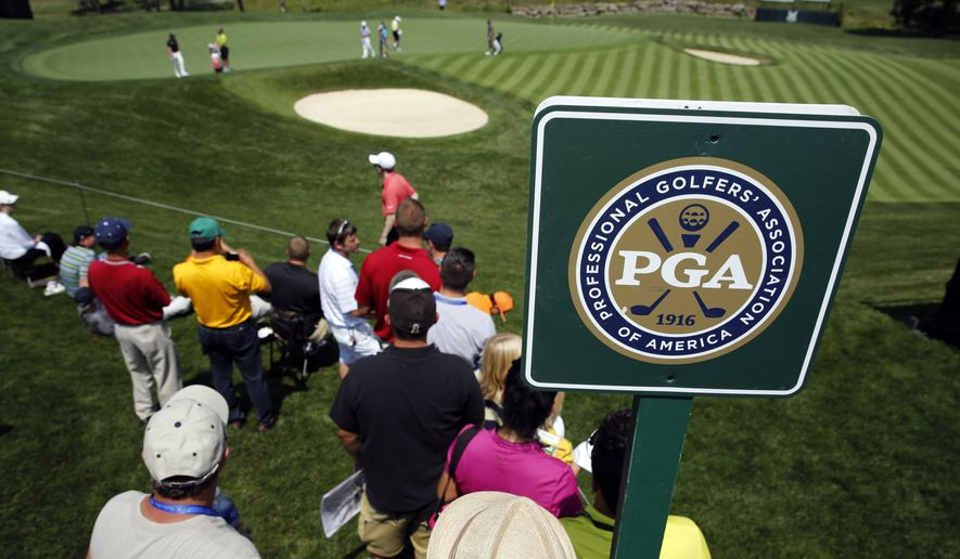 A few fans watch as golfers putt on the 16th green during a practice round at the PGA Championship golf tournament at Valhalla Golf Club Monday, Aug. 4, 2014, in Louisville, Ky. The tournament starts on Thursday. (AP Photo/Jeff Roberson)