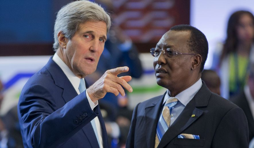 Secretary of State John Kerry, left, talks with Chad President Idriss Deby Itno at the State Department in Washington, Wednesday, Aug. 6, 2014, during the US African Leaders Summit. President Barack Obama and dozens of African leaders opened talks Wednesday on two key issues that threaten to disrupt economic progress on the continent: security and government corruption. (AP Photo/Pablo Martinez Monsivais)