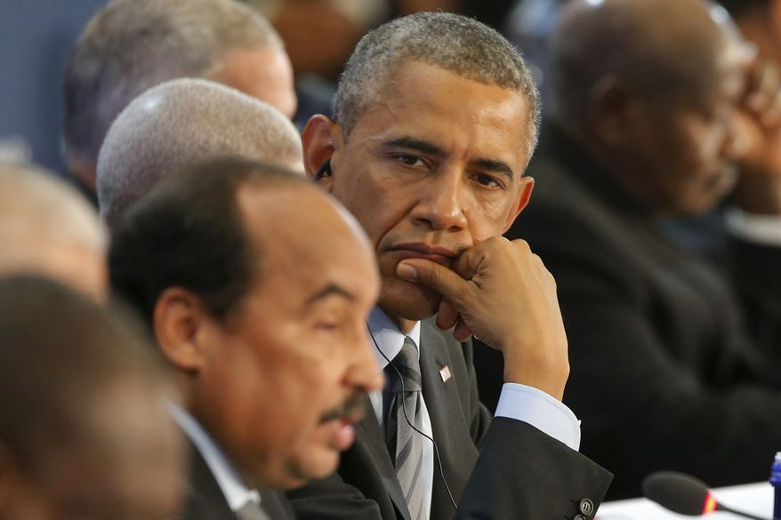 President Barack Obama listens as Mohamed Ould Abdel Aziz, president of the Islamic Republic of Mauritania speaks during the first session of the U.S. Africa Leaders Summit in Washington, Wednesday, Aug. 6, 2014. (AP Photo/Charles Dharapak)