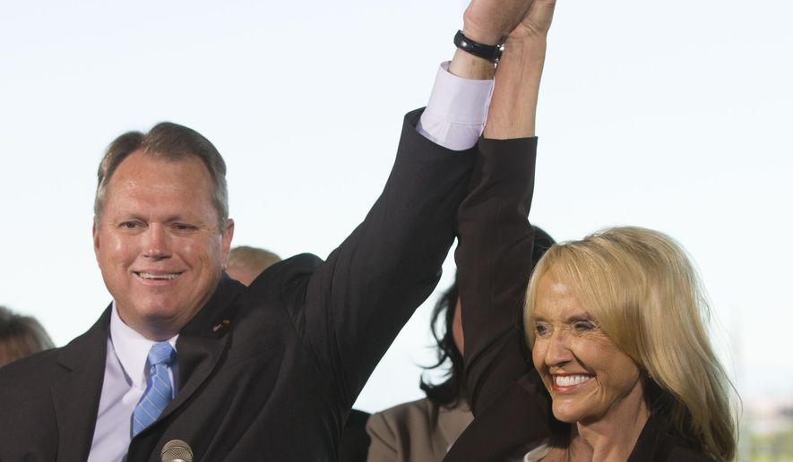 Arizona Gov. Jan Brewer endorses Mesa Mayor Scott Smith for governor during a news conference at Cubs Park in Mesa, Ariz. on Thursday, Aug. 7, 2014. (AP Photo/The Republic, Cheryl Evans)