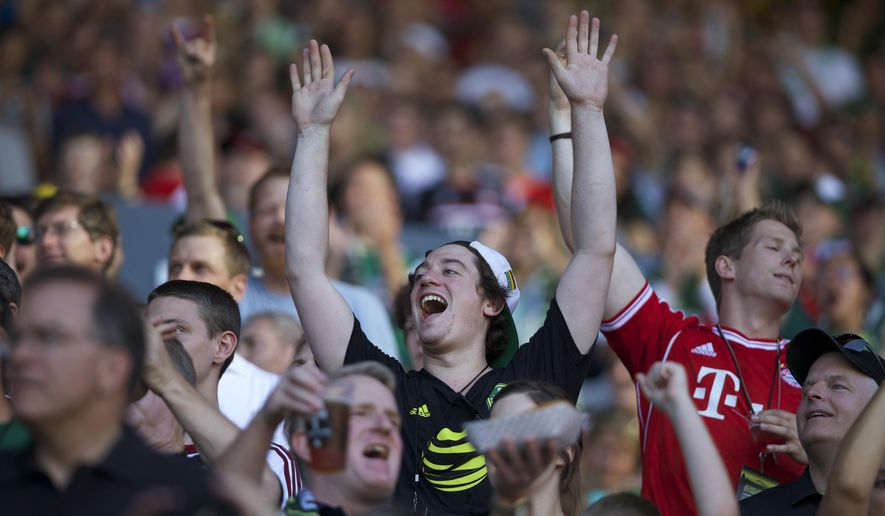 Fans cheer as the MLS All-Stars play Bayern Munich in the MLS All-Star soccer game, Wednesday, Aug. 6, 2014, in Portland, Ore. (AP Photo/The Oregonian, Bruce Ely)