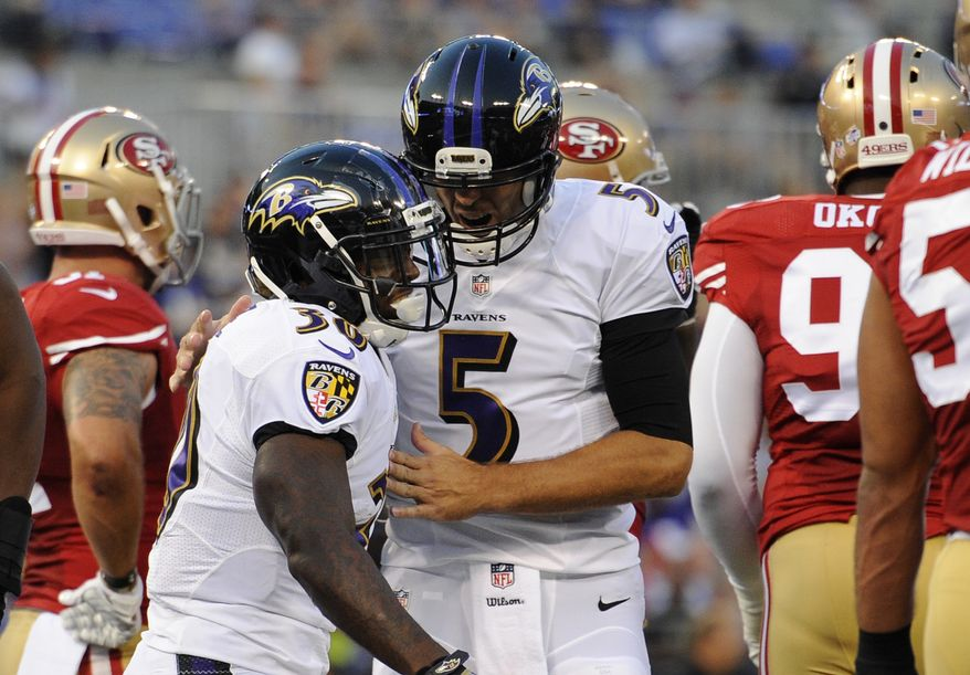 Baltimore Ravens running back Bernard Pierce, left, and quarterback Joe Flacco celebrate Pierce's touchdown in the first half of an NFL preseason football game against the San Francisco 49ers, Thursday, Aug. 7, 2014, in Baltimore. (AP Photo/Nick Wass)