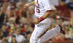 St. Louis Cardinals' Matt Carpenter (13) scores on an RBI double by teammate Matt Adams against the Boston Red Sox in the first inning in a baseball game, Wednesday, Aug. 6, 2014, at Busch Stadium in St. Louis. (AP Photo/Bill Boyce)