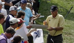 Kenny Perry signs autographs during a practice round for the PGA Championship golf tournament at Valhalla Golf Club on Wednesday, Aug. 6, 2014, in Louisville, Ky. The tournament is set to begin on Thursday. (AP Photo/John Locher)