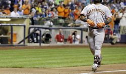 San Francisco Giants' Pablo Sandoval reacts as he runs home after hitting a two-run home run during the eighth inning of a baseball game against the Milwaukee Brewers on Wednesday, Aug. 6, 2014, in Milwaukee. (AP Photo/Morry Gash)
