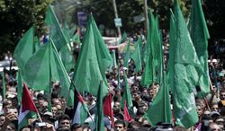 Palestinian Hamas supporters gather for a rally in Gaza City, Gaza Strip, Thursday, Aug. 7, 2014. Thursday's rally drew several thousand supporters and a senior Hamas official has told supporters at the rally that the war with Israel won't be over until the group's political demands are met. Israel and Hamas were holding indirect negotiations in Cairo, Egypt about new border arrangements for blockaded Gaza and extending a cease-fire. (AP Photo/Lefteris Pitarakis)