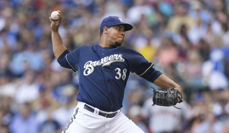 Milwaukee Brewers' Wily Peralta pitches to a San Francisco Giants' batter during the first inning of a baseball game Thursday, Aug. 7, 2014, in Milwaukee. (AP Photo/Tom Lynn)