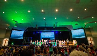 Children and volunteers take part in a worship rally to close out the last day of vacation Bible school at the Church at Severn Run in Maryland's Anne Arundel County. (Photographs by Eva Russo/Special to The Washington Times)