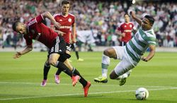 Celtic's Emilio Izaguirre, right, and Legia Warsaw's Lukasz Broz battle for the ball during their Champions League qualifying soccer match at Murrayfield, Edinburgh, Wednesday Aug. 6, 2014. (AP Photo/PA, Jeff Holmes) UNITED KINGDOM OUT  NO SALES  NO ARCHIVE