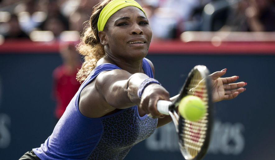 Serena Williams ,of the United States returns the ball to Lucie Safaroa, of the Czech Republic, at the Rogers Cup tennis tournament, Thursday, Aug. 7, 2014, in Montreal. (AP Photo/The Canadian Press, Paul Chiasson)