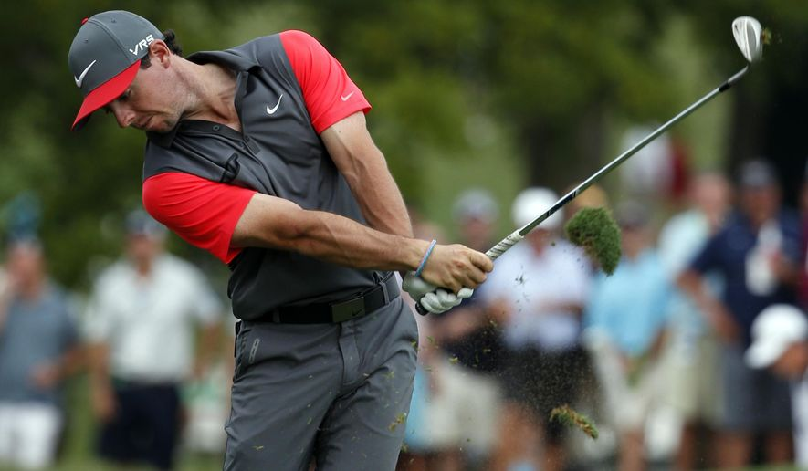 Rory McIlroy, of Northern Ireland, hits from the fairway on the 18th hole during the first round of the PGA Championship golf tournament at Valhalla Golf Club on Thursday, Aug. 7, 2014, in Louisville, Ky. (AP Photo/Mike Groll)