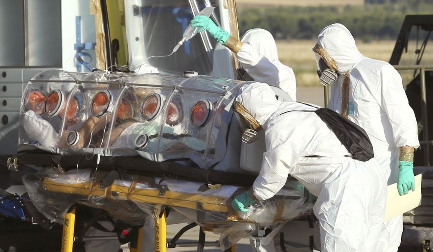 In this photo provided by the Spanish Defense Ministry, aid workers and doctors transfer Miguel Pajares, a Spanish priest who was infected with the Ebola virus while working in Liberia. (AP Photo/Spanish Defense Ministry)