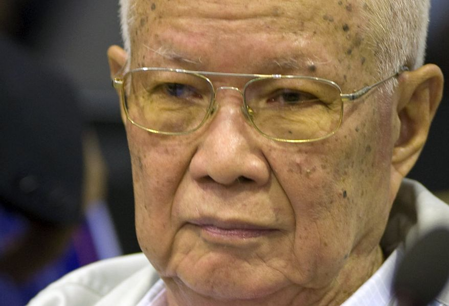 In this photo released by the Extraordinary Chambers in the Courts of Cambodia, Khieu Samphan, the Khmer Rouge's former head of state, sits inside the courtroom of a U.N.-backed war crimes tribunal in Phnom Penh, Cambodia, Thursday, Aug. 7, 2014. Three and a half decades after the genocidal rule of Cambodia's Khmer Rouge ended, the U.N.-backed tribunal on Thursday sentenced Khieu Samphan and Nuon Chea, two top leaders of the former regime, to life in prison for crimes against humanity during the country's 1970s terror period that left close to 2 million people dead. (AP Photo/Extraordinary Chambers in the Courts of Cambodia, Mark Peters)