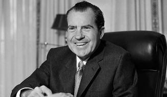 FILE - This Jan. 21, 1969 file photo shows President Richard Nixon at his desk at the White House in Washington. Nixon suffered a stroke in 1994 and died days later at age 81. Saturday, Aug. 9, 2014, marks the 40th anniversary of his resignation. (AP Photo/File)