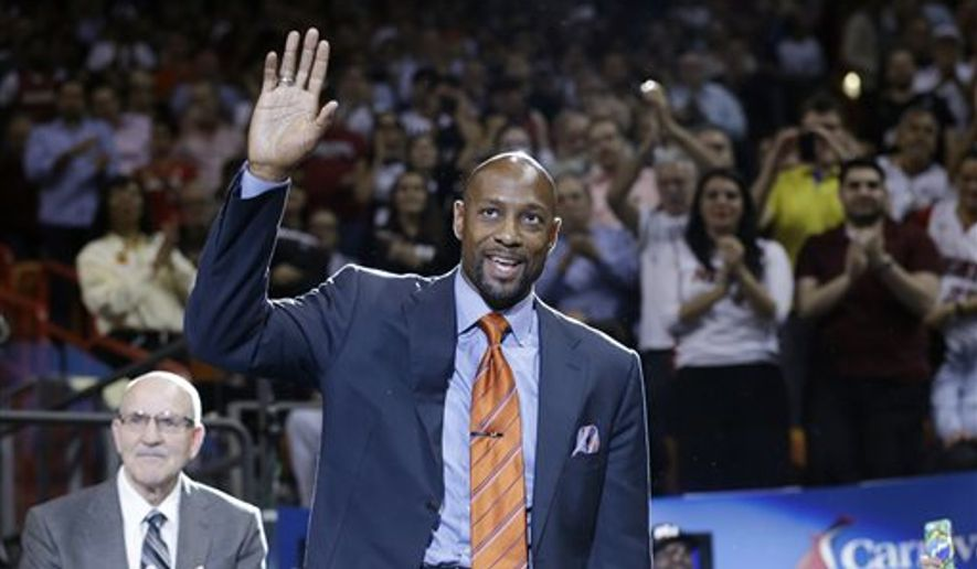 FILE - In this April 8, 2014 file photo, Alonzo Mourning gestures to the crowd after he received a video tribute and loud ovation during the first half of an NBA basketball game between the Miami Heat and the Brooklyn Netsin Miami. His fire was like none other, and that fire led him to the Basketball Hall of Fame. (AP Photo/Wilfredo Lee, File)