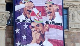 A banner hung across from the U.S. embassy in Moscow addressing President Obama on his 53rd birthday. Twitter@KevinRothrock