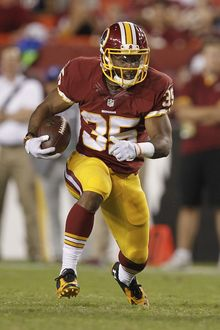 Washington Redskins running back Lache Seastrunk carries the ball during the second half of an NFL football preseason game against the New England Patriots in Landover, Md., Thursday, Aug. 7, 2014. (AP Photo/Connor Radnovich)