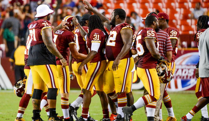 teammates congratulate Washington Redskins kicker Zach Hocker (4) after he makes a tackle on a kick off in the fourth quarter as the Washington Redskins play the New England Patriots in NFL preseason football at FedExField, Landover, Md.,  Thursday, August 7, 2014. (Andrew Harnik/The Washington Times)Monday, September 9, 2013. (Andrew Harnik/The Washington Times)