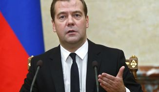Russian Premier Dmitry Medvedev announces sanctions at the Cabinet meeting in Moscow on Thursday, Aug. 7, 2014.The Russian government has banned all imports of meat, fish, milk and milk products and fruit and vegetables from the United States, the European Union, Australia, Canada and Norway, Prime Minister Dmitry Medvedev announced Thursday. The move was taken on orders from President Vladimir Putin in response to sanctions imposed on Russia by the West over the crisis in Ukraine. The ban has been introduced for one year.   (AP Photo/RIA Novosti, Dmitry Astakhov, Government Press Service)