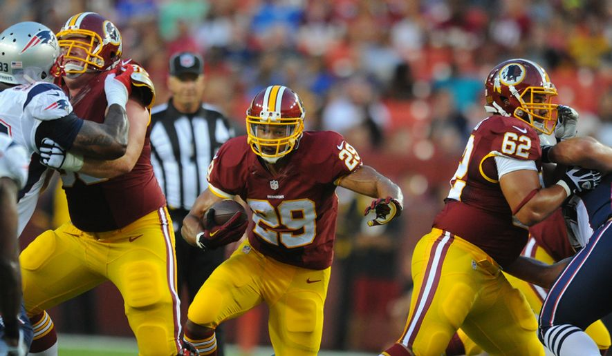 Washington Redskins running back Roy Helu (29) runs through the hole during first quarter action against the New England Patriots at FedEx Field, Aug. 7, 2014. (Preston Keres/Special for The Washington Times)