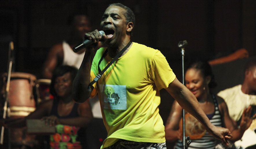 "FILE - This June 13, 2013 file photo shows singer Femi Kuti performing at the New Afrika Shrine in Lagos, Nigeria. The son of Fela Kuti, whose career as a musician and political activist was celebrated by the three-time Tony Award winning play ""Fela!,"" has in recent days been thinking more than ever about his father with the release of the latest work on his life, ""Finding Fela."" The documentary by Academy Award-winning director Alex Gibney is playing in major U.S. cities. (AP Photo/Jon Gambrell, File)"