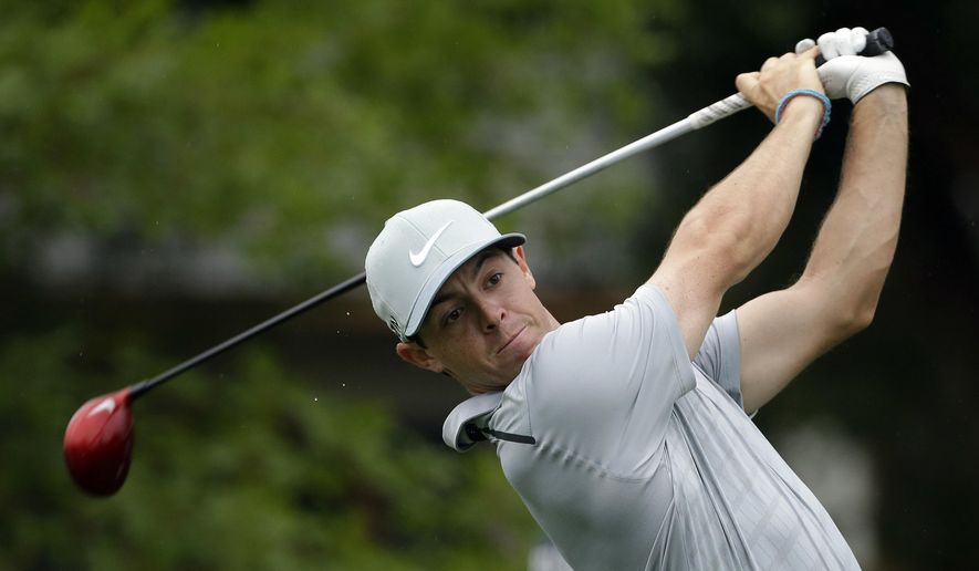 Rory McIlroy, of Northern Ireland, watches his tee shot on the 10th hole during the second round of the PGA Championship golf tournament at Valhalla Golf Club on Friday, Aug. 8, 2014, in Louisville, Ky. (AP Photo/David J. Phillip)