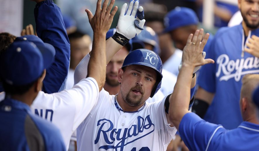 Kansas City Royals' Billy Butler celebrates with teammates after hitting a two-run home run in the first inning during a baseball game against the San Francisco Giants, Friday, Aug. 8, 2014, in Kansas City, Mo. (AP Photo/Ed Zurga)