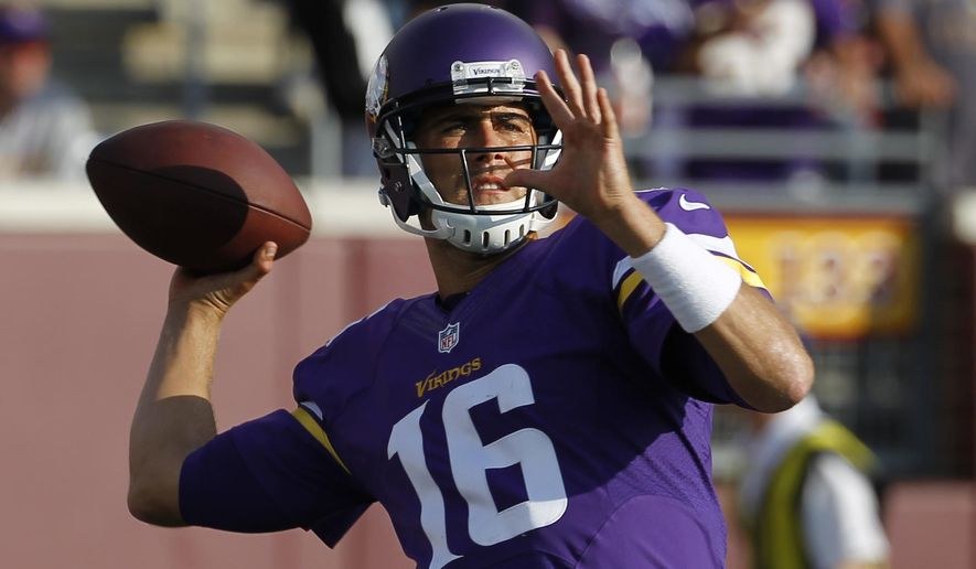 Minnesota Vikings quarterback Matt Cassel throws before a preseason NFL football game against the Oakland Raiders in Minneapolis, Friday, Aug. 8, 2014. (AP Photo/Ann Heisenfelt)