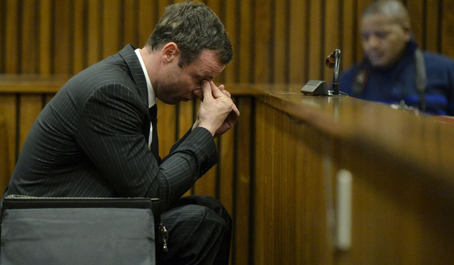 Oscar Pistorius, gestures, as he sits in court, during his trial in Pretoria, South Africa, Friday, Aug. 8, 2014. The chief defense lawyer for Oscar Pistorius delivered final arguments in the athlete's murder trial on Friday, alleging that Pistorius thought he was in danger when he killed girlfriend Reeva Steenkamp and also that police mishandled evidence at the house where the shooting happened.(AP Photo/Herman Verwey, Pool)