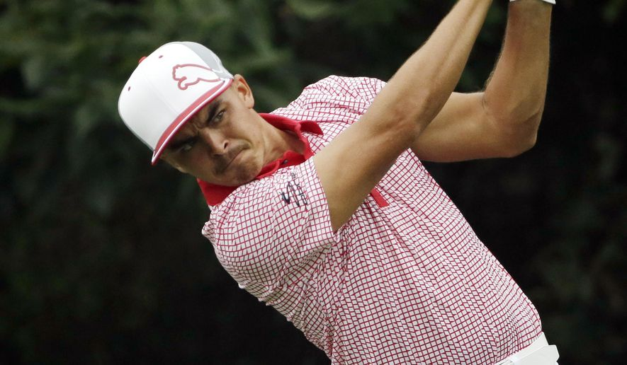 Rickie Fowler watches his tee shot on the 18th hole during the second round of the PGA Championship golf tournament at Valhalla Golf Club on Friday, Aug. 8, 2014, in Louisville, Ky. (AP Photo/David J. Phillip)