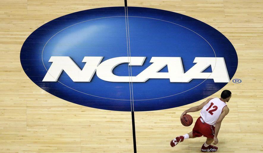 ** FILE ** In this March 26, 2014, file photo, Wisconsin's Traevon Jackson dribbles past the NCAA logo during practice at the NCAA men's college basketball tournament in Anaheim, Calif. (AP Photo/Jae C. Hong, File)