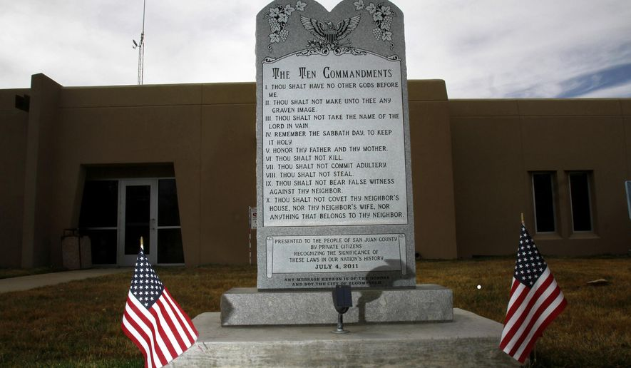 "File- This March 13, 2014, file photo shows the Bloomfield Ten Commandments monument at Bloomfield City Hall in Bloomfield, N.M. A federal judge on Thursday, Aug. 7, 2014,  ruled that the city must remove the monument. Senior U.S. District Judge James A. Parker said in his ruling in a lawsuit filed by the American Civil Liberties Union that the monument amounts to government speech and has the ""principal effect of endorsing religion."" (AP Photo/The Daily Times, Jon Austria)"