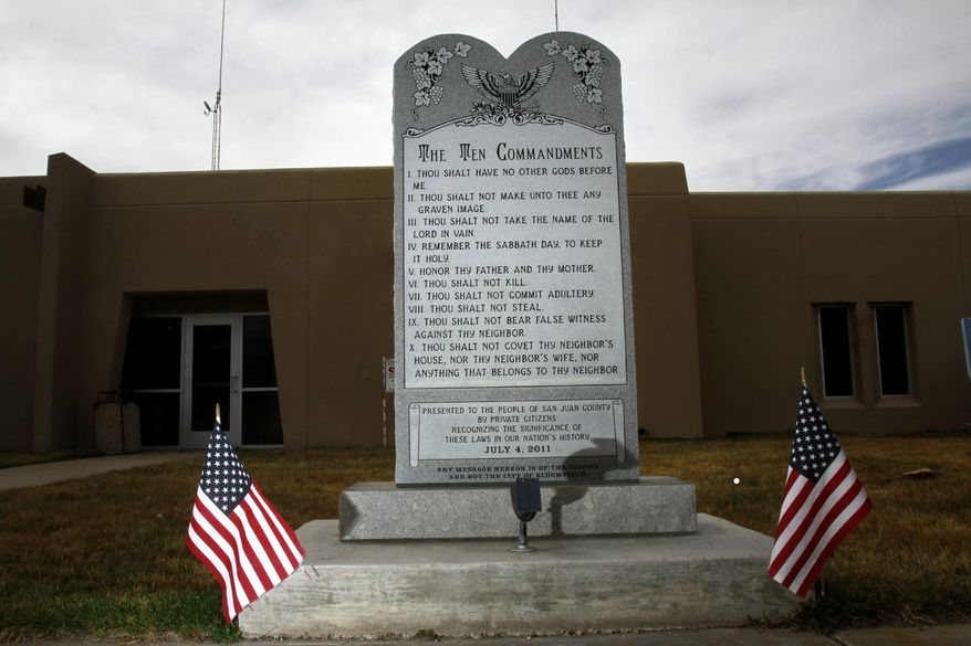 """File- This March 13, 2014, file photo shows the Bloomfield Ten Commandments monument at Bloomfield City Hall in Bloomfield, N.M. A federal judge on Thursday, Aug. 7, 2014,  ruled that the city must remove the monument. Senior U.S. District Judge James A. Parker said in his ruling in a lawsuit filed by the American Civil Liberties Union that the monument amounts to government speech and has the """"principal effect of endorsing religion."""" (AP Photo/The Daily Times, Jon Austria)"""