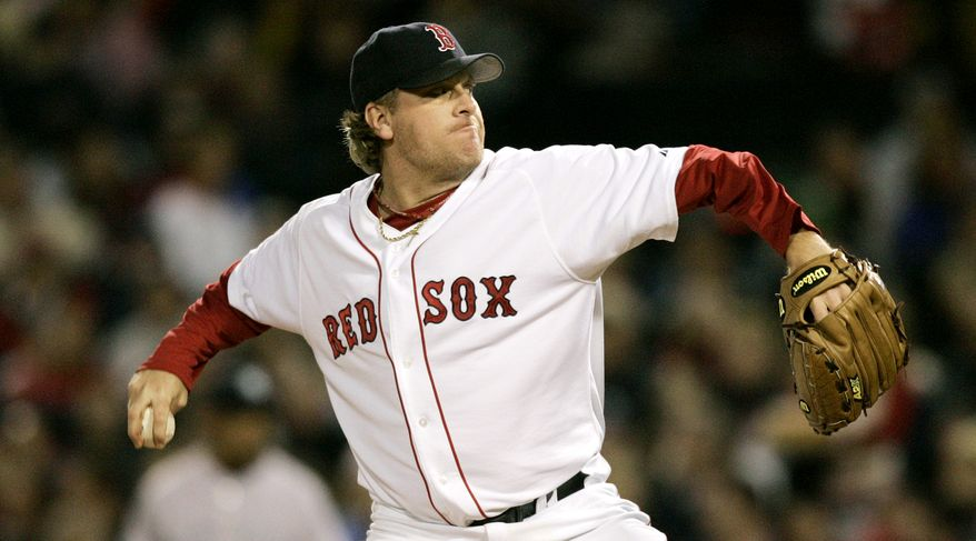 Boston Red Sox starter Curt Schilling delivers a throw during the eighth inning against the New York Yankees at Fenway Park in Boston, Monday, May 22, 2006. (AP Photo/Charles Krupa) ** FILE **