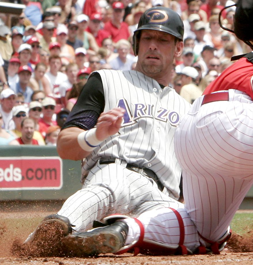 LUIS GONZALEZ-The former MLB outfielder is a prominent member of the Republican Party. Arizona Diamondbacks' Luis Gonzalez, left, slides safely into home plate in back of Cincinnati Reds' catcher David Ross, right, after a Conor Jackson hit in the first inning of their baseball game, Sunday, May 28, 2006 in Cincinnati. (AP Photo/David Kohl)