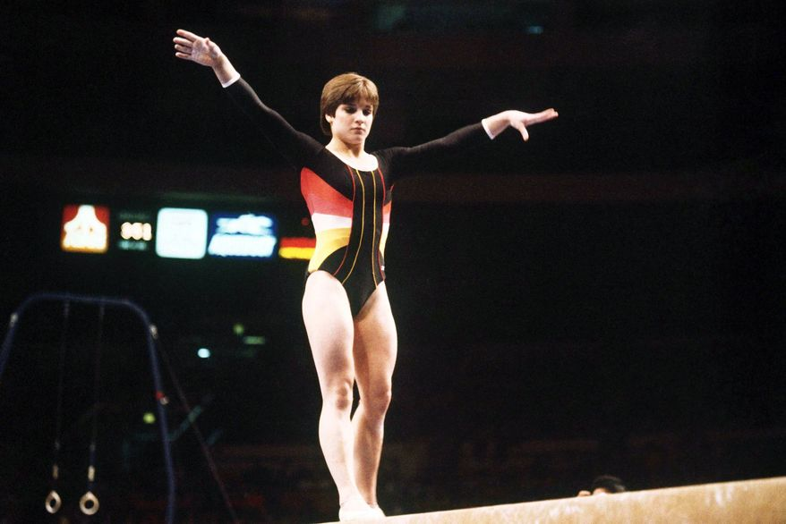 MARY LOU RETTON-The Olympic gold medalist delivered the Pledge of Allegiance at the 2004 Republican National Convention. Mary Lou Retton on the balance beam March 5, 1984. (AP Photo)