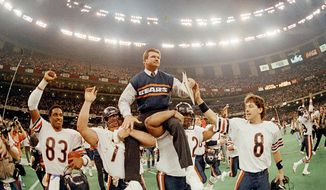 Chicago Bears head coach Mike Ditka is carried off the field by Steve McMichael, left, and William Perry after the Bears win Super Bowl XX in New Orleans, La., on Jan. 26, 1986. (AP Photo/Phil Sandlin) ** FILE **