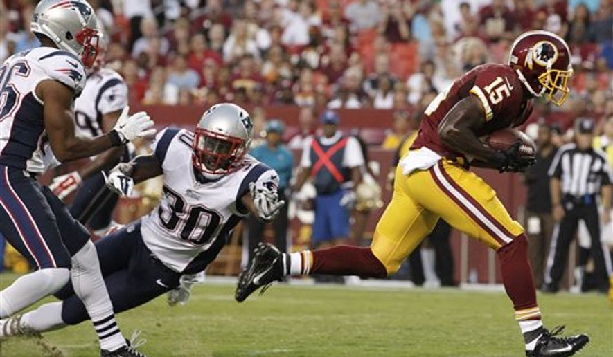 Washington Redskins wide receiver Aldrick Robinson breaks free from New England Patriots strong safety Duron Harmon (30) and scores a touchdown during the first half of an NFL football preseason game in Landover, Md., Thursday, Aug. 7, 2014. (AP Photo/Alex Brandon)