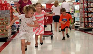 As soon as they the catch a glimpse of the backpack display in the back of the store, Molly, left, Meghan and Kurt Schwartz make a mad dash to start their shopping on Tuesday, July 22, 2014, at Target.  Their brother Cole is behind the cart. The Schwartz quadruplets are headed to kindergarten this year.(AP Photo/St. Louis Post-Dispatch, Laurie Skrivan)