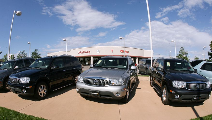 FILE - In this Aug. 27, 2006 file photo, a trio of unsold 2006 Buick Rainier sports utility vehicles sits in front of a Buick dealership in the southeast Denver suburb of Lone Tree, Colo. General Motors' troubles with safety recalls have surfaced in another case, this time with the company recalling a group of SUVs, including the 2006 Buick Rainier, for a third time to fix power window switches that can catch fire. (AP Photo/David Zalubowski, File)