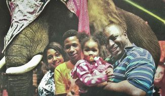 FILE- In this undated family photo provided by the National Action Network, Eric Garner, right, poses with his children during a family outing. On July 17, 2014, police on New York City's Staten Island tried to arrest Garner by placing him in an illegal choke hold, which ended up causing his death. The New York City police are at odds with Mayor Bill de Blasio over the appearance that he is taking sides against in them in the aftermath of Garner's death. (AP Photo/Family photo via National Action Network, File)