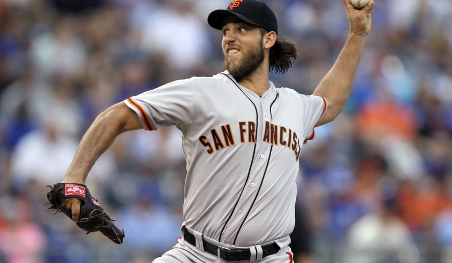 San Francisco Giants starting pitcher Madison Bumgarner throws in the first inning during a baseball game against the Kansas City Royals, Friday, Aug. 8, 2014, in Kansas City, Mo. (AP Photo/Ed Zurga)