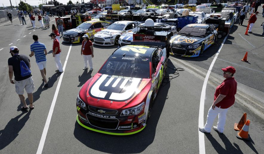 Race cars are lined up nose-to-tail behind Jeff Gordon's race car near the garage area before a qualifying session for Sunday's NASCAR Sprint Cup Series auto race at Watkins Glen International, Saturday, Aug. 9, 2014, in Watkins Glen N.Y. (AP Photo/Mel Evans)
