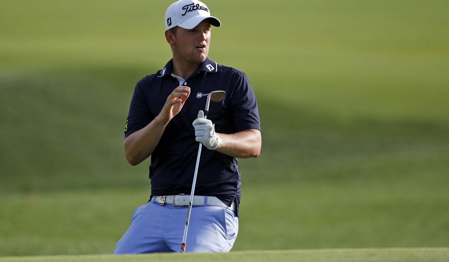 Bernd Wiesberger, of Austria, reacts to a chip on the 18th hole during the third round of the PGA Championship golf tournament at Valhalla Golf Club on Saturday, Aug. 9, 2014, in Louisville, Ky. (AP Photo/Mike Groll)